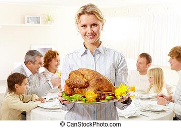 Festive dish - Portrait of pretty woman with roasted turkey ...