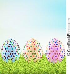 Festive Easter eggs on the grass