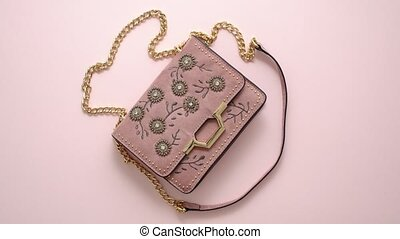 Festive evening women bag isolated on pink background. ...