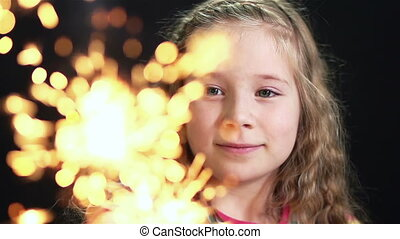 Festive Fire - Close-up of a charming girl enjoying the...