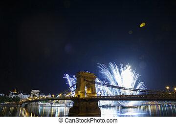 Festive fireworks over the Szechenyi Chain Bridge in Budapest