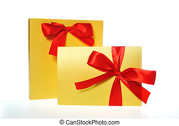 festive gold box with a red bow on a white background