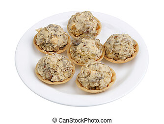 Festive handmade New Year's tartlets with mushrooms and yolk isolated