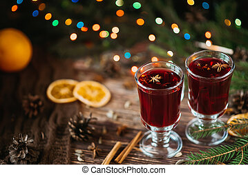 festive hot winter drink mulled wine in glasses with Christmas decor