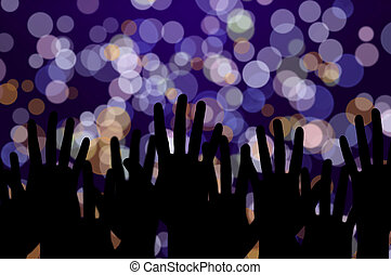 Festive lights and people hands on night music concert
