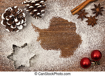 Festive motif of flour in the shape of Antarctica (series)
