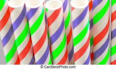 Festive multicolored striped cocktail tubes, camera movement