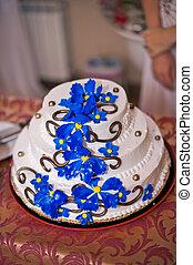 Beautiful festive pie with a pattern from dark blue flowers.