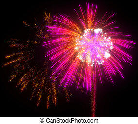 Festive red and lilac fireworks at night