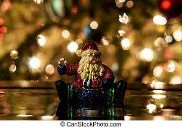 Festive santa with Christmas light background