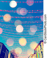 Festive street in gay neighborhood decorated with pink balls