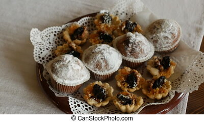 Festive sweets and cupcakes are on the holiday table,...