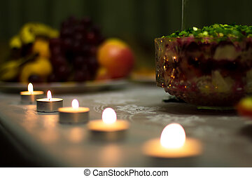 Festive table served treats and decorated with candles.
