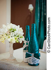 Festive table setting in the restaurant with flowers. Wedding decor.