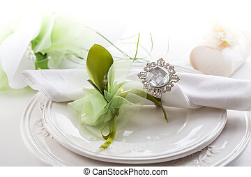 Festive table setting with bouquet on plate