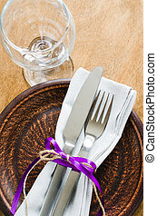 Festive Table Setting With Napkin and Cutlery.