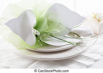 Festive table setting with small gift on plate