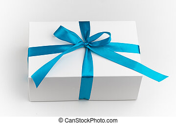 festive white gift box with blue bow