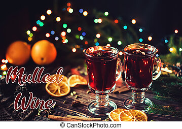 hot alcoholic drink mulled wine in glasses with Christmas decor