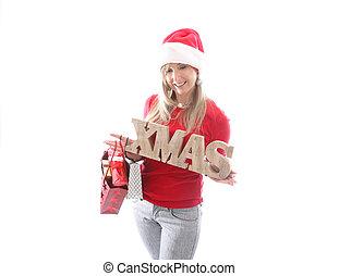 Festive woman holding a Xmas sign