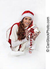 Festive woman holding gift