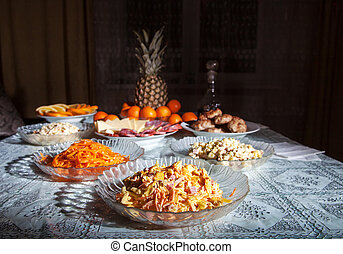 festively laid table with salads at night