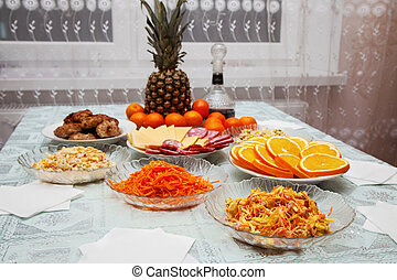 festively laid table with salads