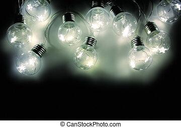Festoon light bulbs isolated on black background