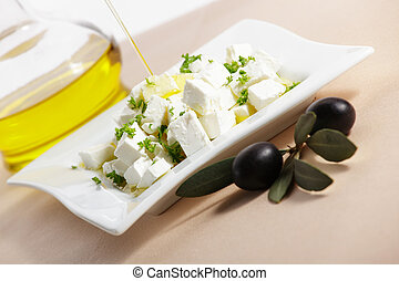 feta cheese with olive branch