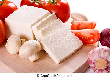 Feta cheese with vegetables - White cheese with tomato,...