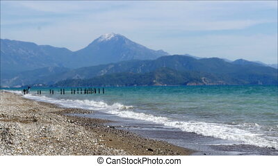 """fethiye, turkey mediterranean beach by sea in winter, cloudy day"""