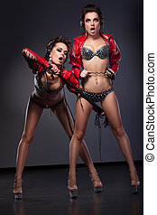 Fetish. Funny Sexy Women in Erotic Pose with Whip. Excitement