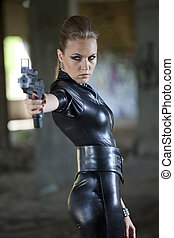 fetish woman with gun - young woman in fetish leather suit ...