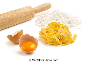 fettuccine, eggs, flour and wooden rolling pin