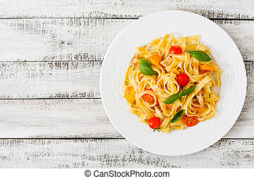 Fettuccine pasta in tomato sauce with chicken, tomatoes...