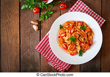 Fettuccine pasta with shrimp, tomatoes and herbs