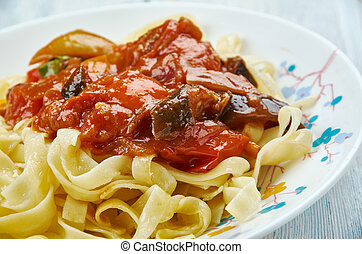 Fettuccine with tomato eggplant sauce, close up