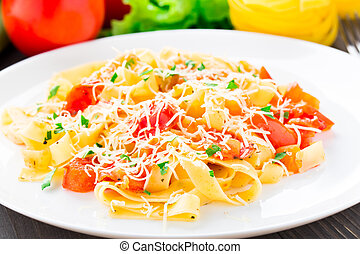 Fettuccine with tomato on a white plate