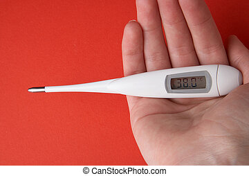 Fever - Fieber - white thermometer laying in a hand -...