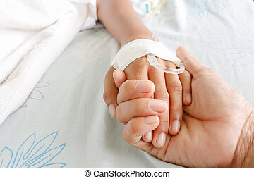 fever patients - mother holding child's hand who fever...