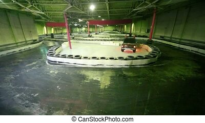 Few carts rides on race track laid in premises under roof