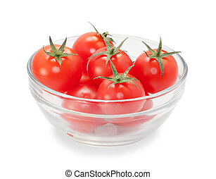Few cherry tomatoes with leaves in glass transparent bowl