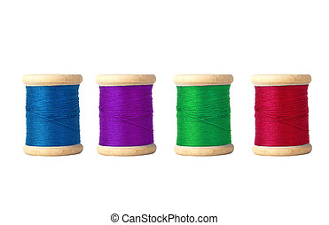Few color bobbins isolated on white