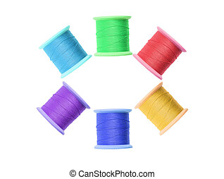 Few colorful thread bobbins isolated on white