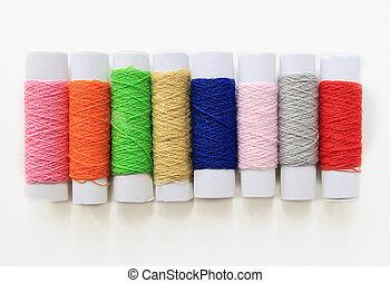 few nice colorful bobbins on white background