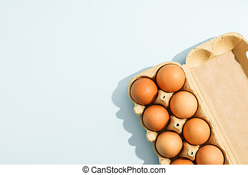 Few raw chicken eggs in carton box on white background, space for text