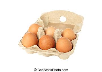 Few raw chicken eggs in carton box on white background