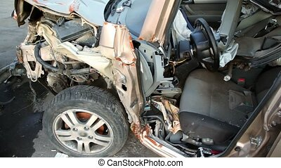 Few scrapped vehicles after car accident stand on junk yard