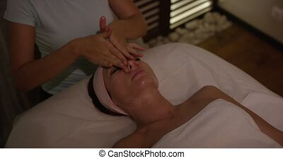 FEW SHOTS Spa facial Massage. Face Massage in beauty spa salon. Beauty Treatments. Body care, skin care, wellness, wellbeing, beauty treatment concept.