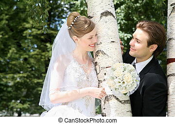 fiance with the bride in the birch